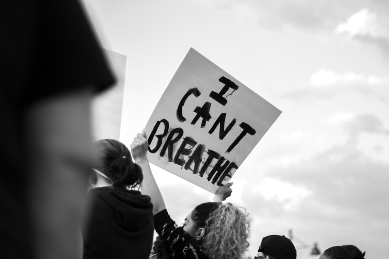 "A protestor holding a sign saying ""I can't breathe"" at a Black Lives Matter protest"